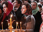 Russian Orthodox Believers Holding Candles at Cathedral at Christmas