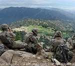 U.S. Troops Atop High Ridge in Afghanistan Looking Over Valley