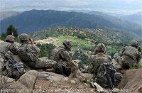 U.S. Troops Atop High Ridge in Afghanistan Looking Over Valley