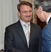 File Photo of German Gref Shaking Hands with U.S. Official
