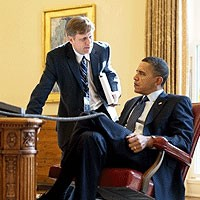 File Photo of Barack Obama Sitting at Desk with Mike McFaul Standing Next to Him Facing Him