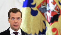 File Photo of Dmitry Medvedev Before Gold Flag with Elaborate Design
