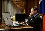 File Photo Dmitry Medvedev at Desk with Laptop Computer
