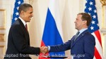 File Photo of Barack Hussein Obama and Dmitry Medvedev with Flags, Shaking Hands