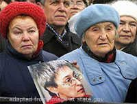File Photo of Mourners with Photo of Anna Politkovskaya