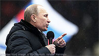 File Photo of Vladimir Putin at Outdoor Rally with Microphone in Hand and Heavy Coat