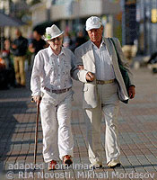 File Photo of Two Elders Walking Outdoors