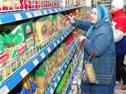 File Photo of Older Russian Woman Shopping in Grocery Store
