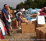 File Photo of Russian Volunteer Effort, With Group of People Outdoors with Boxes