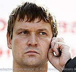 Leonid Razvozzhayev file photo with hand to ear, as if holding cellphone