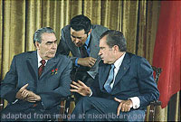 Leonid Brezhnev and Richard Nixon Sitting and Talking, as Nixon Gestures, with Third Man Standing and Leaning Closely Between Them