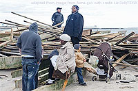 File Photo of Hurricane Sandy Victims and Relief Personnel Near Rubble of Home Destroyed