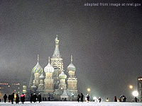 File Photo of Moscow In Snowy Winter Showing St. Basil's At Night in Snowfall, with People on the Ground in the Distance