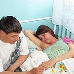File Photo of Russian Expectant Couple with Mother in Hospital Bed