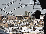 File Photo of Groznya, Looking out Through Hole in Damaged Building at City Landscape in Daylight