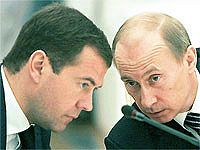Dmitry Medvedev and Vladimir Putin file photo