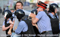 File Photo of Alexei Navalny Being Grabbed by Police at Protest
