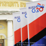 File Photo of Russia-Hosted G20 Banners Outdoors Before Yellow and White Facade of Historic-Looking Building