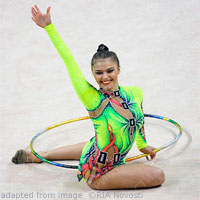 Alina Kabaeva file photo, seated and posturing during gymnatics routine