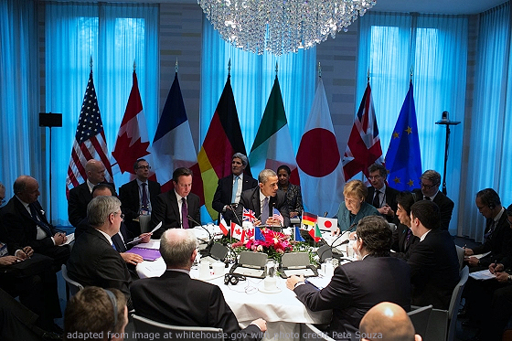File Photo of G7 Leaders and other Officials Around Round Table at the Hague, with Flags