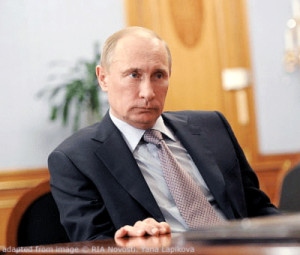 File Photo of Vladimir Putin Sitting at Desk