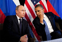 File Photo of Vladimir Putin and Barack Obama Seated with Flags Behind