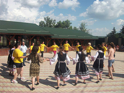 Moldovan Dancers Dancing with Peace Corps Volunteers