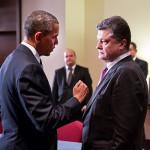 File photo of Barack Obama and Petro Poroshenko facing one another, with Obama gesturing