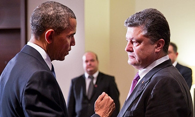 File photo of Barack Obama and Petro Poroshenko facing one another, with Obama gesturing
