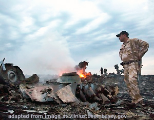 Ukraine Air Crash Scene with Uniformed Security Personnel, Flames, Smoke