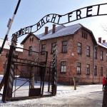 Auschwitz Concentration Entrance with Sign Arbeit Macht Frei