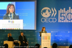 File Photo of Elvira Nabiullina at OECD Event, at Podium and On Large Video Screen
