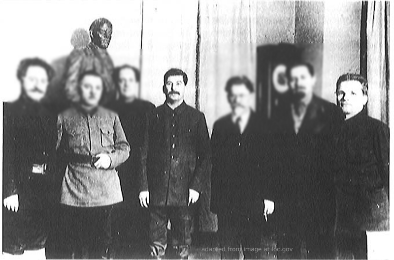 File Photo of Joseph Stalin and Sergei Kirov as Part of Group of Five, Next to Bust of Lenin, with Faces of Other Attendees Partially Blurred