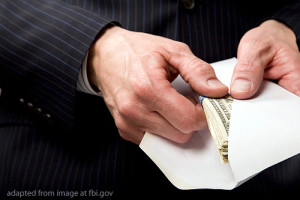 Hand Pulling Cash from Envelope