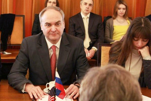 Anatoly Antonov and Others Facing U.S. Official with U.S. and Russian Flags on Table