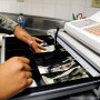 File Photo of Cash Register with Drawer Open and Hands of Cashier