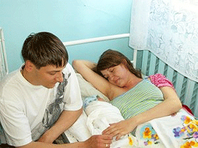 Couple in Hospital with Newborn