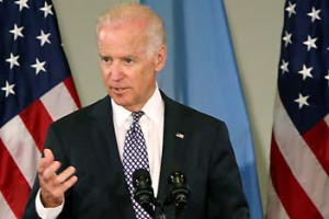 Joe Biden Speaking in Front of U.S. Flags and Ukrainian Flag