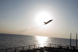 Russian Jet Buzzing U.S. Navy Destroyer, adapted from U.S. Navy photo