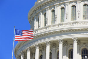 American Flag and Partial View of U.S. Capitol Dome, adapted from image at aoc.gov