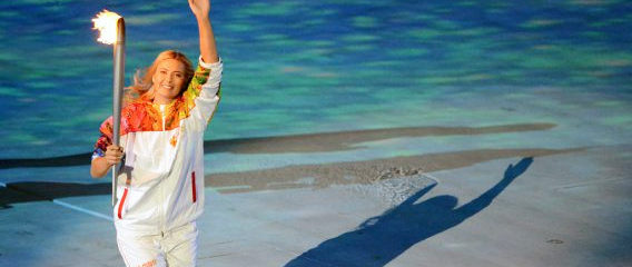 File Photo of Maria Sharapov Carrying Olympic Torch and Waving at Sochi