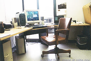 File Photo of Empty Chair and Desk with Computer, adapted from image at osha.gov