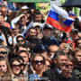 File Photo of Crowd in Russia Including Person Waving Russian Flag with Eagle