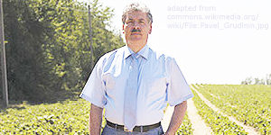 File Photo of Pavel Grudinin in a Farm Field, adapted from wikimedia commons image attributed to user Kelatrat at https://commons.wikimedia.org/wiki/File:Pavel_Grudinin.jpg