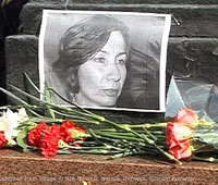 File Photo of Flowers and Photo of Natalya Estemirova