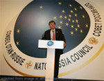 File Photo of Official at Podium in Front of Large NATO-Russia Council Signage