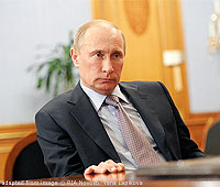 File Photo of Vladimir Putin at Desk