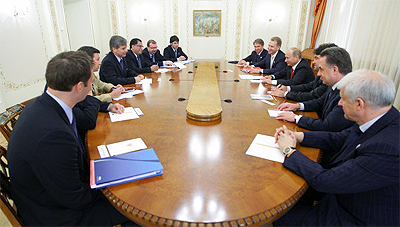 Men Sitting Around Long Oval Boardroom Table, File Photo of FIFA Officials Meeting with Vladmir Putin