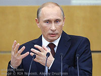 File Photo of Vladimir Putin at Podium Gesturing