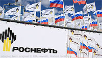 File Photo Rosneft and Russian Flags Next to Rosneft Banner